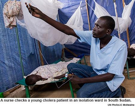 Nurse checks young cholera patient in South Sudan.